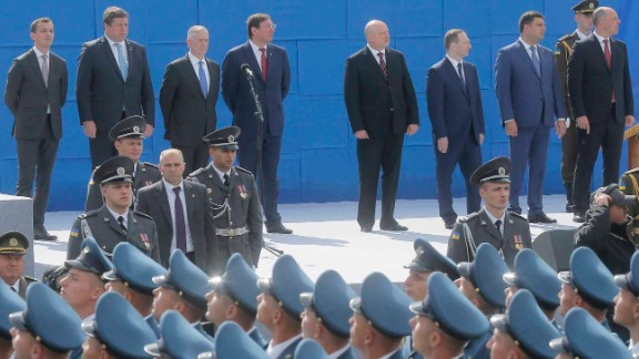 US Defense Secretary James Mattis, 3rd left, and Ukrainian officials watch a military parade to celebrate Independence Day in Kiev on Thursday.