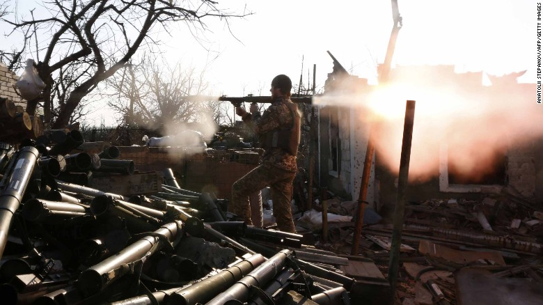 A Ukrainian serviceman shoots with a grenade launcher during fighting with pro-Russian separatists in Donetsk, Ukraine.
