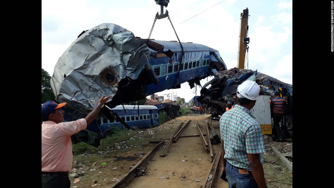 "Wreckage is lifted away after a <a href=""http://www.cnn.com/2017/08/19/asia/india-train-derailment/index.html"" target=""_blank"">deadly train derailment</a> near Khatauli, India, on Saturday, August 19. Eight of the train's cars derailed and toppled over each other, police said."