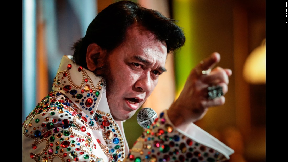 "Jun Espinosa, an Elvis Presley impersonator, performs Saturday, August 19, on his way to winning the Elvis of Asia contest in Makati, Philippines. Presley died 40 years ago this month. <a href=""http://www.cnn.com/2013/08/08/us/gallery/elvis-presley/index.html"" target=""_blank"">See more photos of Elvis through the years</a>"