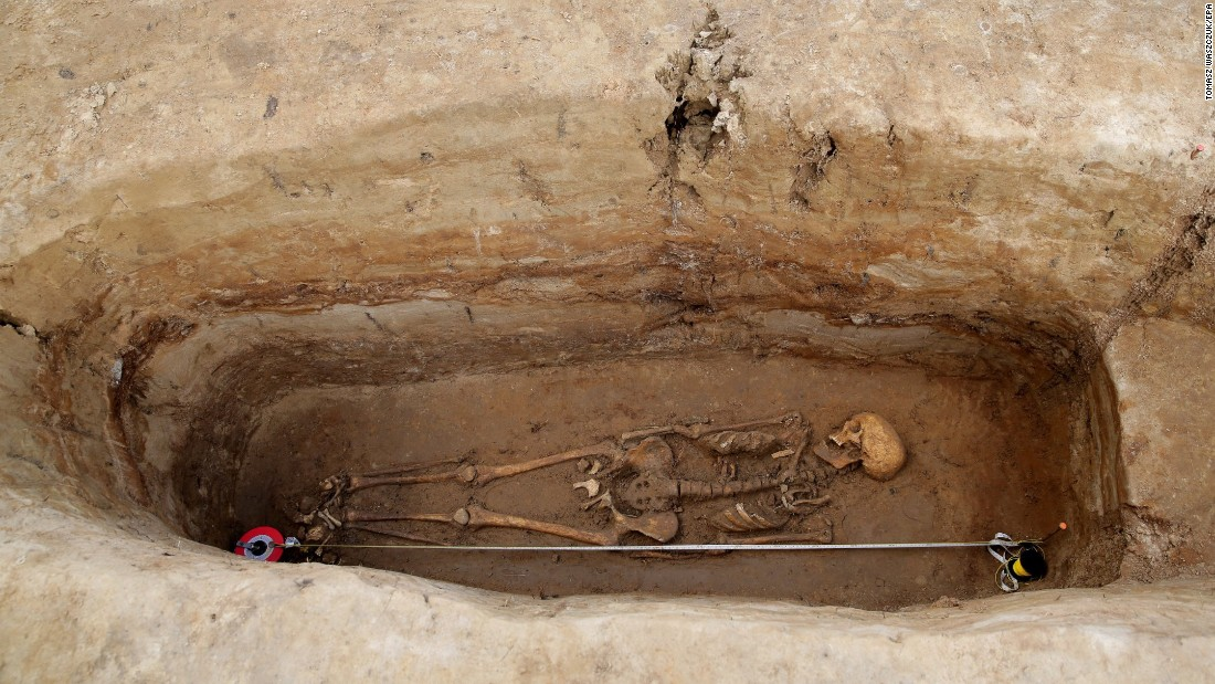 A medieval skeleton is excavated near Barczewko, Poland, on Wednesday, August 23.