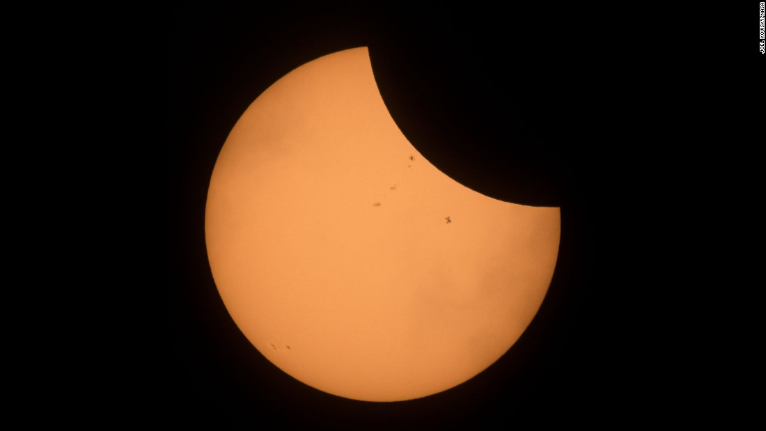 "The International Space Station can be seen on the right, passing in front of the sun, during <a href=""http://www.cnn.com/interactive/2017/08/us/eclipse-photos/"" target=""_blank"">the total solar eclipse</a> on Monday, August 21."