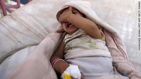 TOPSHOT - A yemeni child, who is suspected of being infected with cholera, cries at a hospital in the capital Sanaa, on August 12, 2017. A cholera outbreak has claimed the lives of some 2,000 Yemenis in less than four months. / AFP PHOTO / Mohammed HUWAIS        (Photo credit should read MOHAMMED HUWAIS/AFP/Getty Images)