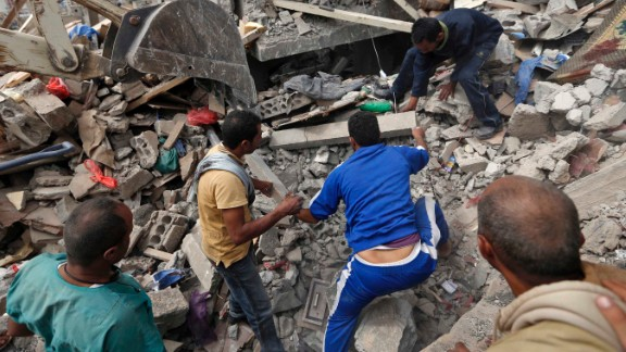Yemenis search under the rubble of a house destroyed in an air strike in a residential area of the capital Sanaa on August 25, 2017.