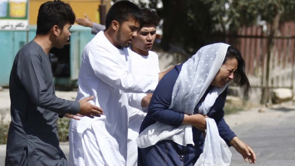 epa06161676 Afghan civilians flee the site of attack that targeted a Shiite Muslim mosque during Friday congregational prayers in Kabul, Afghanistan, 25 August 2017. Initial reports say a bomb went off and four gunmen attacked a Shiite mosque in Kabul during Friday noon prayers. Security forces have cordoned off the area and a battle is continuing with the gunmen with several people are feared dead in the attack.  EPA-EFE/JAWAD JALALI