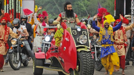"FILE- In this Wednesday, Oct. 5, file 2016 photo, Indian spiritual guru, who calls himself Saint Dr. Gurmeet Ram Rahim Singh Ji Insan, arrives for a press conference ahead of the release of his new film ""MSG, The Warrior Lion Heart,"" in New Delhi, India. Several cities in north India were under a security lock down Thursday ahead of a verdict in a rape trial involving the controversial and hugely popular spiritual leader. (AP Photo/Tsering Topgyal, File)"