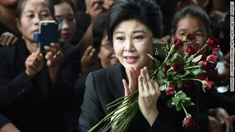 Former Thai prime minister Yingluck Shinawatra speaks to the media as she arrives at the Supreme Court in Bangkok on July 21, 2017. A final court hearing is expected in the negligence trial of ousted Yingluck, who faces up to a decade in jail in a case lambasted by her supporters as politically-motivated.  / AFP PHOTO / LILLIAN SUWANRUMPHA        (Photo credit should read LILLIAN SUWANRUMPHA/AFP/Getty Images)