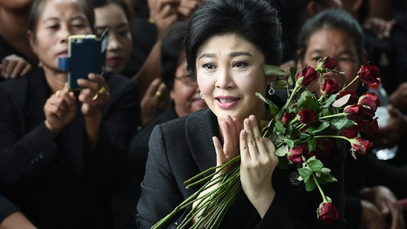Former Thai prime minister Yingluck Shinawatra speaks to the media as she arrives at the Supreme Court in Bangkok on July 21, 2017.