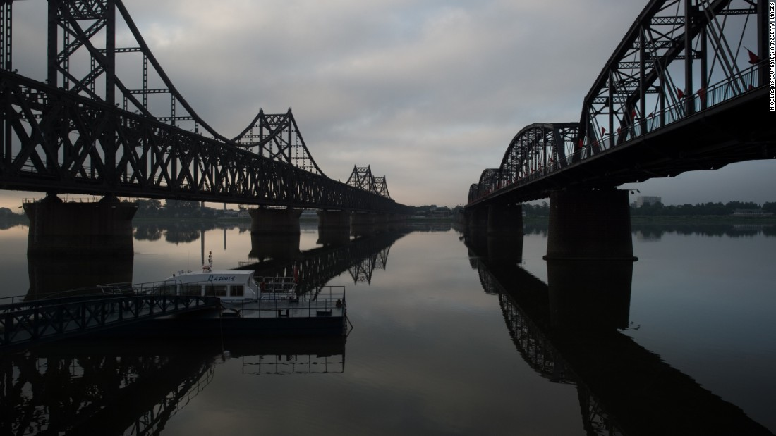 <strong>Northern link:</strong> The sun rises over the Friendship Bridge on the Yalu River, which links North Korea and China in the north.