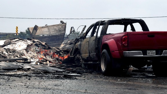 A burnt out house and cars that caught fire are seen after Hurricane Harvey hit Corpus Christi, Texas on August 26, 2017. Hurricane Harvey slammed into the Texas coast late Friday, unleashing torrents of rain and packing powerful winds, the first major storm to hit the US mainland in 12 years.