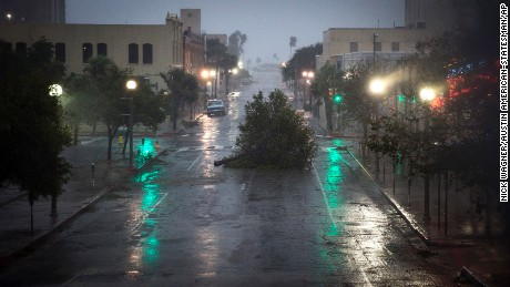 A tree blocks a street as Hurricane Harvey makes landfall in Corpus Christi, Texas, on Friday, August 25, 2017. Hurricane Harvey smashed into Texas late Friday, lashing a wide swath of the Gulf Coast with strong winds and torrential rain from the fiercest hurricane to hit the U.S. in more than a decade.