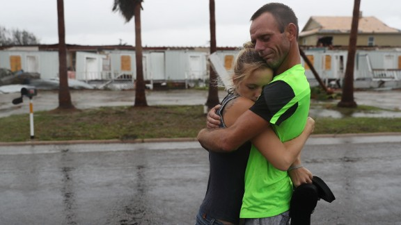 Jessica Campbell hugs Jonathan Fitzgerald after riding out Hurricane Harvey in an apartment on August 26, 2017, in Rockport.