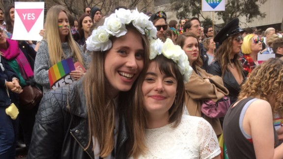 """Jane Mahoney, 28, and Josie Lennie, 26, danced and kissed in front of the crowd after a celebrant officiated over a """"mass illegal wedding"""" in Melbourne Saturday, August 26."""
