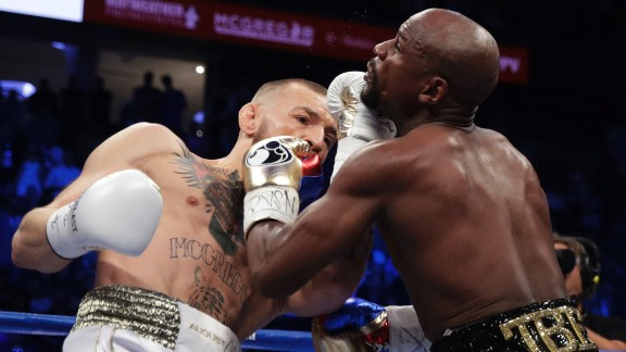 McGregor lands an uppercut early in the bout. He came out aggressive and took the fight to Mayweather in the first few rounds.