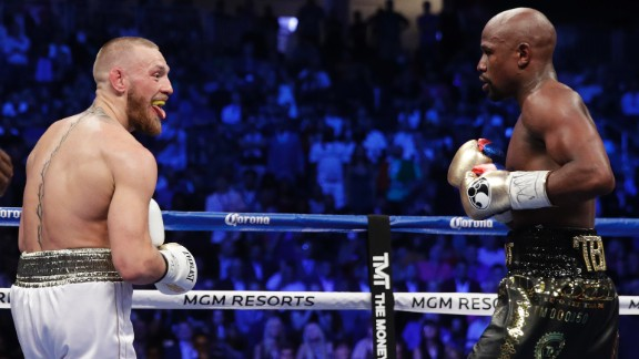 McGregor sticks his tongue out at Mayweather during an early exchange.