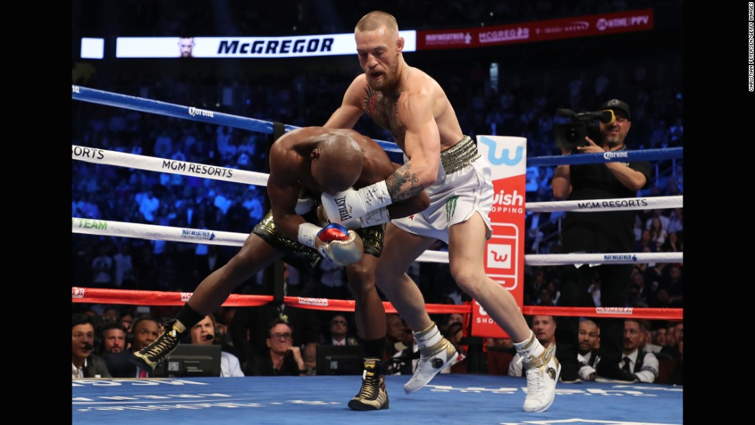 There were several awkward exchanges when McGregor would end up behind Mayweather.