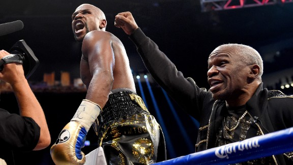 Mayweather and his father celebrate the victory.