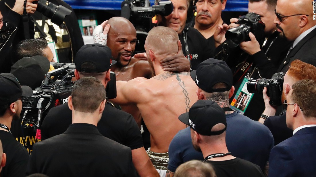 The two combatants embrace after the fight.