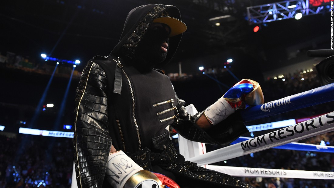 Mayweather came out in all black and wore a mask.