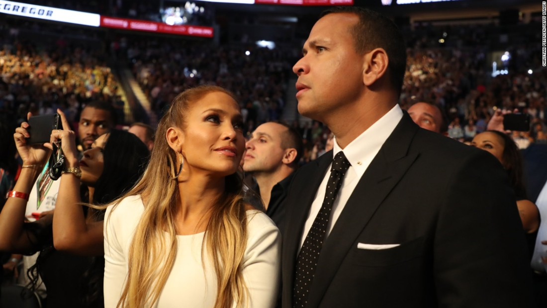 Actress Jennifer Lopez and her boyfriend, former baseball star Alex Rodriguez, take in the fight.