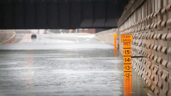 A guage shows the depth of water a an underpass on Interstate 10 which has been inundated with flooding from Hurricane Harvey on August 27, 2017 in Houston, Texas. Harvey, which made landfall north of Corpus Christi late Friday evening, is expected to dump upwards to 40 inches of rain in Texas over the next couple of days.