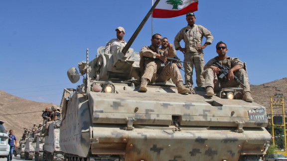 Lebanese army soldiers sit a top an armoured personnel carrier (APC) as they drive in the eastern town of Ras Baalbek, on August 21, 2017, upon returning from the mountainous frontline where an offensive against the Islamic State group on the country's eastern border with Syria after capturing a third of the territory IS held in the region. / AFP PHOTO / STRINGER        (Photo credit should read STRINGER/AFP/Getty Images)