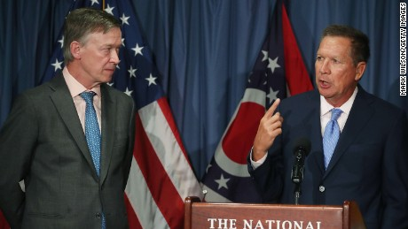 Gov. John Kasich (R-OH) (R) and Gov. John Hickenlooper (D-CO) participate in a bipartisan news conference to discuss the Senate health care reform bill at the National Press Club on June 27, 2017 in Washington, DC.