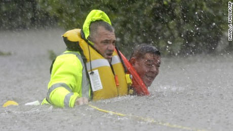 Wilford Martinez, is rescued from his flooded car along Interstate 610 in floodwaters from Tropical Storm Harvey Sunday, August 27, 2017, in Houston, Texas.