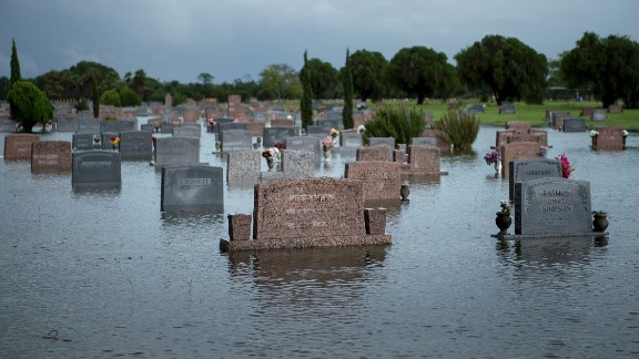 A graveyard is flooded in Pearland, Texas.
