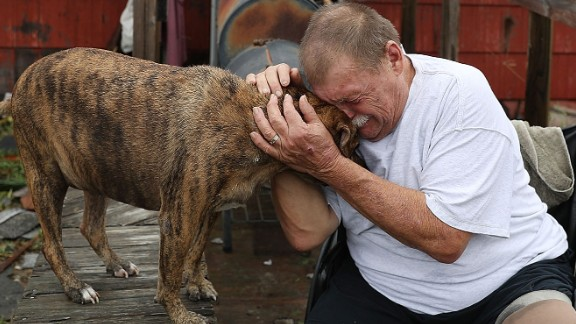 Steve Culver comforts his dog Otis in the hurricane aftermath. Harvey destroyed most of his home in Rockport while he and his wife were there.