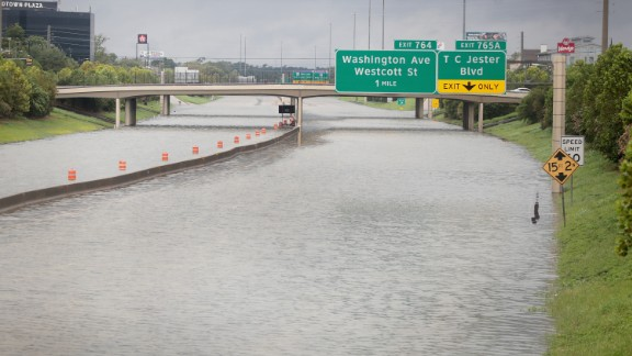 Water flows down Interstate 10 in Houston amid record flooding from Hurricane Harvey.