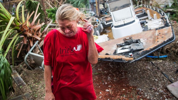Melani Zurawski cries while inspecting her home in Port Aransas, Texas.