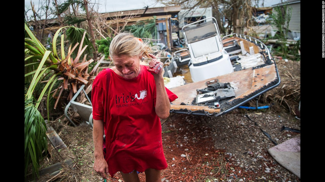 Melani Zurawski cries while inspecting her home in Port Aransas on August 27.