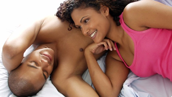 Happy couple on bed. Shutterstock ID 50530990; PO: Photo Desk/Health