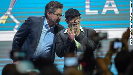 "FARC leaders Rodrigo Londono Echeverri (R), known as ""Timochenko"" and Ivan Marquez attend the opening of their National Congress in Bogota on August 27, 2017 Colombia's leftist FARC rebels sought political rebirth on Sunday as they launched steps to transform into a party and seek elected office after disarming to end a half-century war. / AFP PHOTO / Raul Arboleda        (Photo credit should read RAUL ARBOLEDA/AFP/Getty Images)"