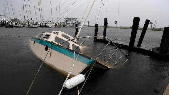 A boat lies crippled Saturday in Rockport