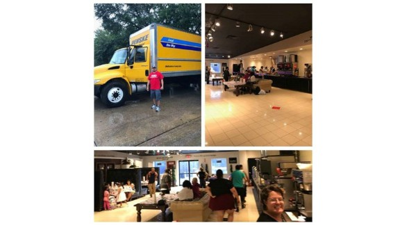 Gallery Furniture shared photos of one of their drivers using a company truck to rescue people and flood victims taking shelter in one of their stores.