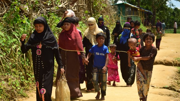 Amena Khatun, second from the left, and her family enter Balukhali camp in Cox