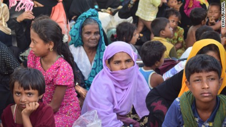 Rohingya woman Sayra Begum sits with her relatives at a shelter in Cox's Bazar.