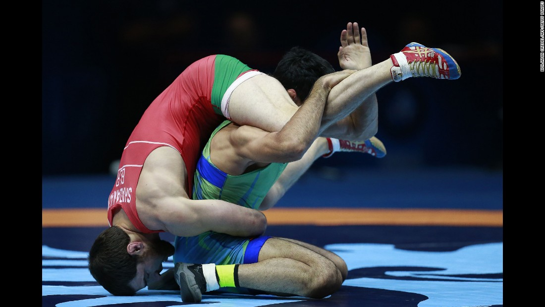 Belarusian wrestler Ali Shabanau, left, competes against Uzbekistan's Bekzod Abdurakhmonov during the World Wrestling Championships on Saturday, August 26. Shabanau won the match to earn a bronze medal in their weight class.