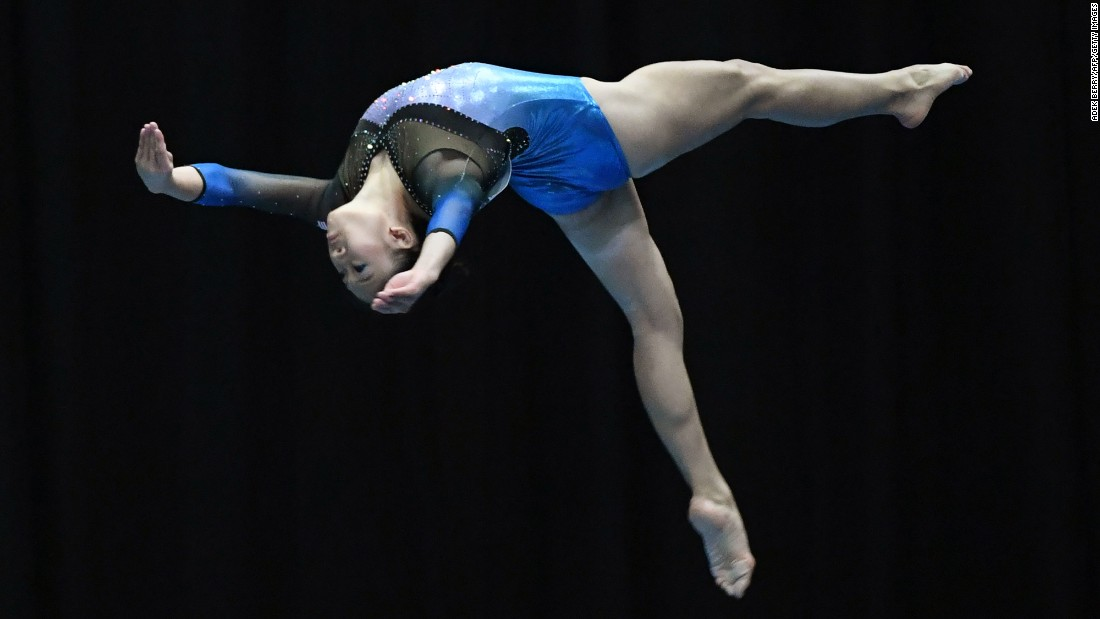 Malaysian gymnast Tan Ing Yueh competes on the balance beam during the Southeast Asian Games on Wednesday, August 23.