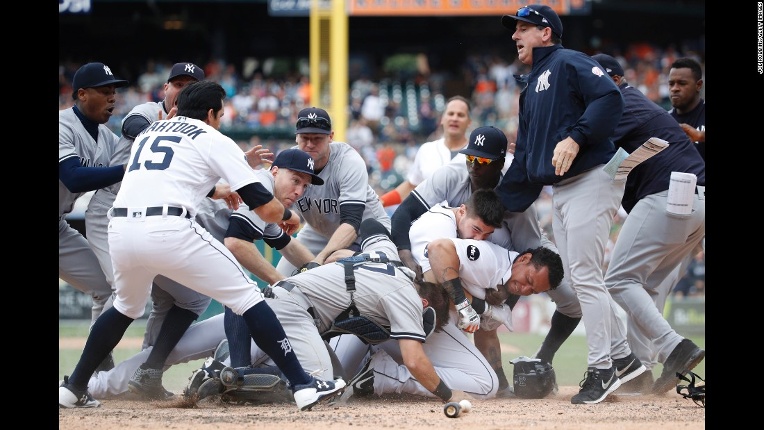 Benches cleared after Detroit's Miguel Cabrera started fighting with New York Yankees catcher Austin Romine, bottom, on Thursday, August 24. The fight came minutes after Yankees pitcher Tommy Kahnle was ejected for throwing a pitch behind Cabrera. Cabrera started arguing with Romine, and then he shoved him and threw the first punch. Cabrera and Romine were ejected following their fight, and they weren't the only players to get thrown out of what was a heated game with several incidents.