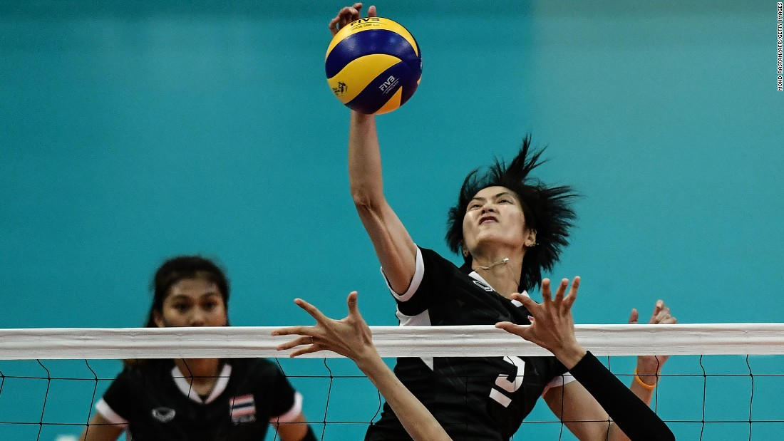 Thai volleyball player Pleumjit Thinkaow spikes the ball against the Philippines during a semifinal match at the Southeast Asian Games on Saturday, August 26. Thailand would go on to win the tournament on both the men's and the women's side.