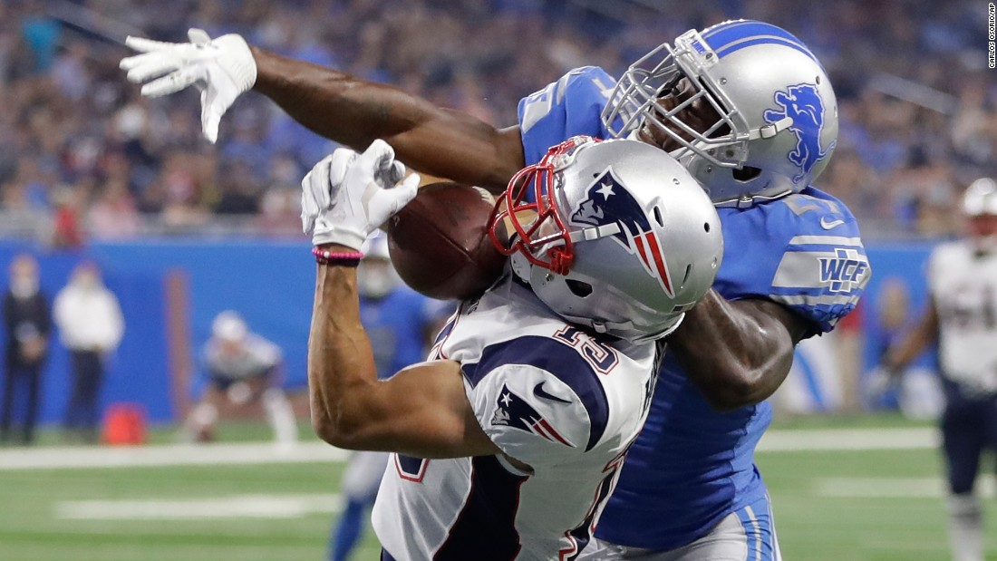 New England wide receiver Chris Hogan pulls in a 32-yard touchdown pass as he's defended by Detroit's Nevin Lawson during an NFL preseason game on Friday, August 25.