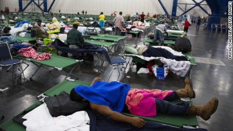 HOUSTON, TX - AUGUST 28:  Evacuees fill up cots at the George Brown Convention Center that has been turned into a shelter run by the American Red Cross to house victims of the high water from Hurricane Harvey on August 28, 2017 in Houston, Texas. Harvey, which made landfall north of Corpus Christi late Friday evening, is expected to dump upwards to 40 inches of rain in areas of Texas over the next couple of days.  (Photo by Erich Schlegel/Getty Images