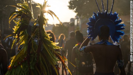 LONDON, ENGLAND - AUGUST 28:  Performers and revellers make their way home at the end of the Notting Hill Carnival on August 28, 2017 in London, England. The Notting Hill Carnival has taken place since 1966 and now has an attendance of over two million people.  (Photo by Chris J Ratcliffe/Getty Images)