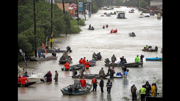 Rescue boats fill Tidwell Road in Houston as they help flood victims evacuate the area.
