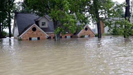 Floodwaters surround a home in Spring, Texas, on August 28.