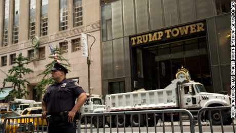 NEW YORK, NY - AUGUST 14: A New York City Police Officer (NYPD) stands guard across the street from Trump Tower on Fifth Avenue, August 14, 2017 in New York City. Numerous protests are expected throughout the city today as President Trump is expected to arrive this evening at his home at Trump Tower, which will be his first visit back to his 5th Avenue apartment since the inauguration. (Photo by Drew Angerer/Getty Images)