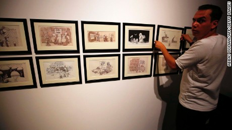 Cartoons by Naji al-Ali on display at the Palestinian Museum on August 26 in the West Bank town of Birzeit, near Ramallah.